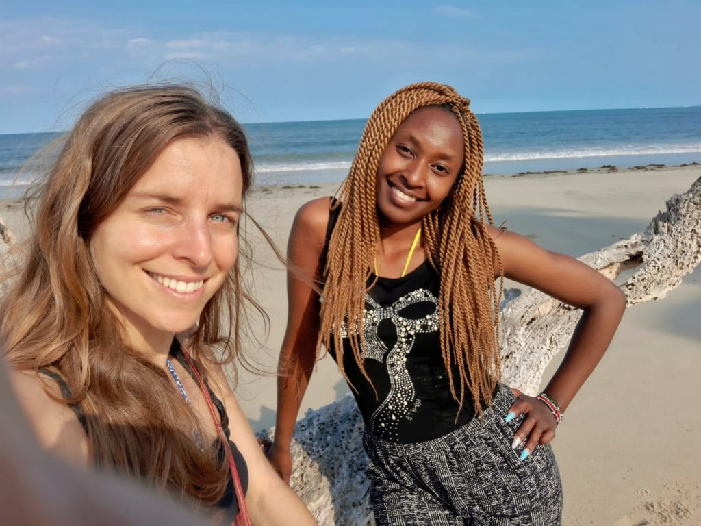 A photo of two women on the beach by weonboard.com