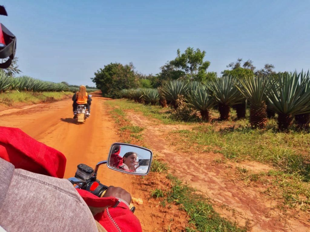 A photo of a woman in a motocycle on a dirt road by weonboard.com