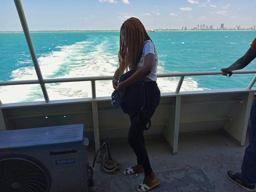 A photo of a woman on the ferry to tanzania by weonboard.com