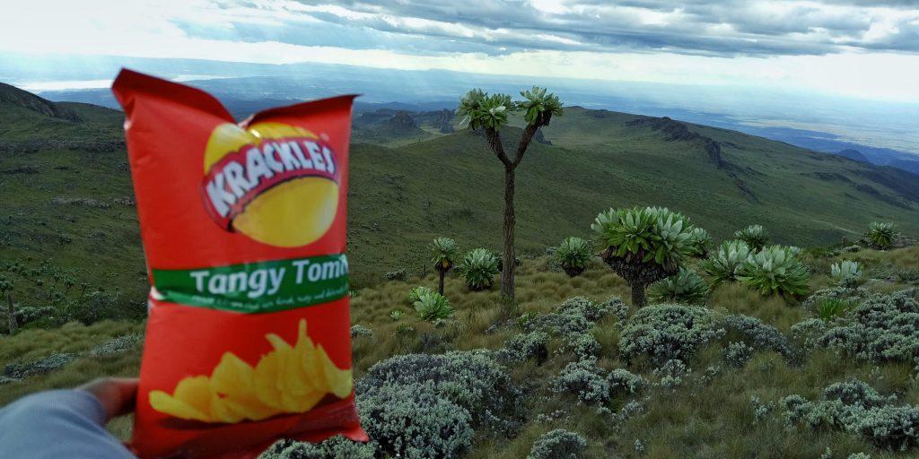 A photo of a bag of crisps over Mt. Satima scenery